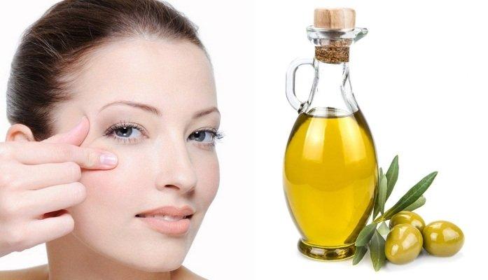 Женское лицо и оливковое масло