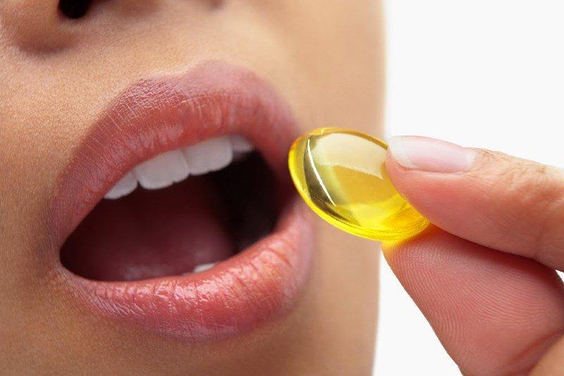 Прием витамина A в масле