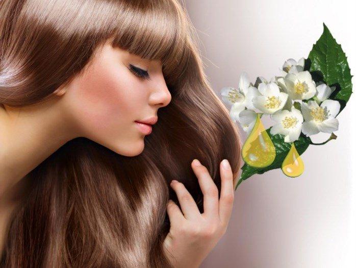 Девушка с красивыми волосами и масло жасмина